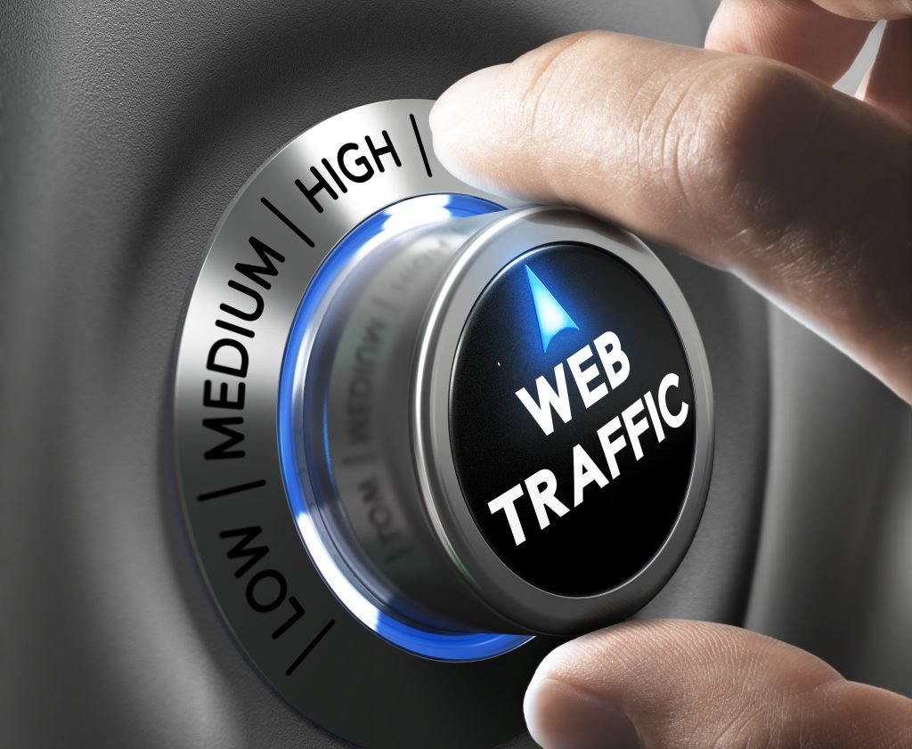 Man holding a dial that is pointed at high for web traffic